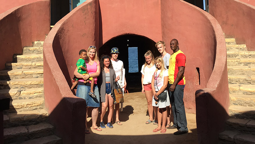Family outside their home in Africa