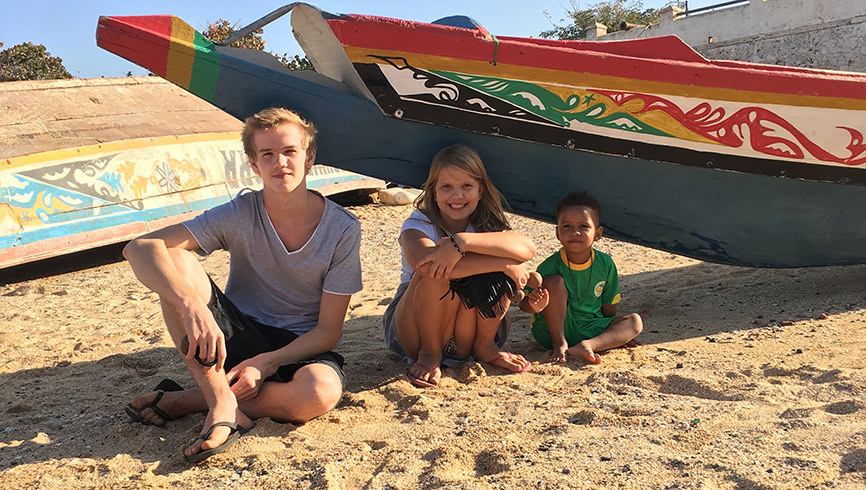 Brothers and sister at the beach in Africa